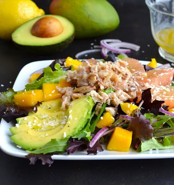 Tropical Crab Salad - mixed greens topped with creamy avocado, sweet mango, crunchy red onion and crab with a tropical dressing! | @tasteLUVnourish