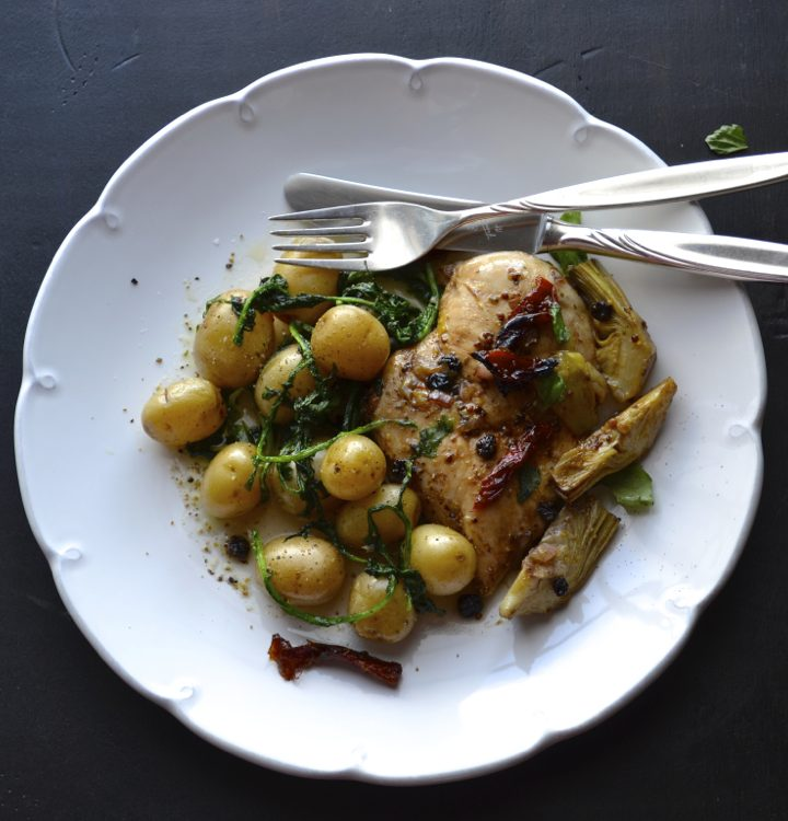 Roasted Balsamic Chicken with Artichoke with tiny potatoes sautéed with garlic and arugula. Fast, easy and impressive. | From @tasteLUVnourish on www.tasteloveandnourish.com