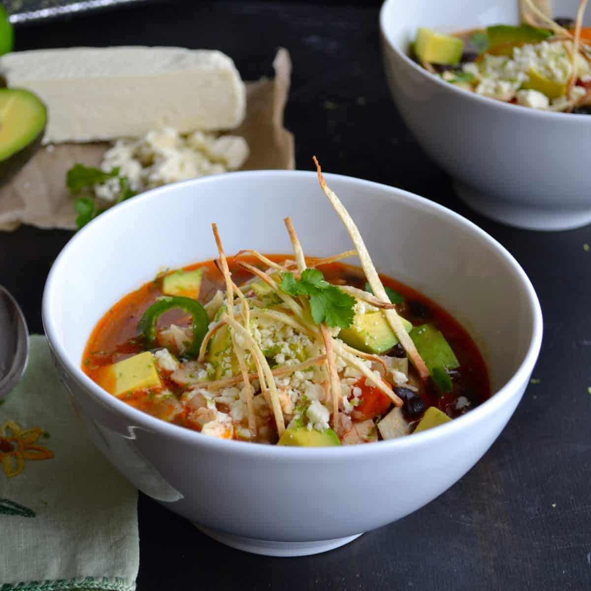 Tortilla Soup topped with avocado, cotija cheese and thin tortilla ...