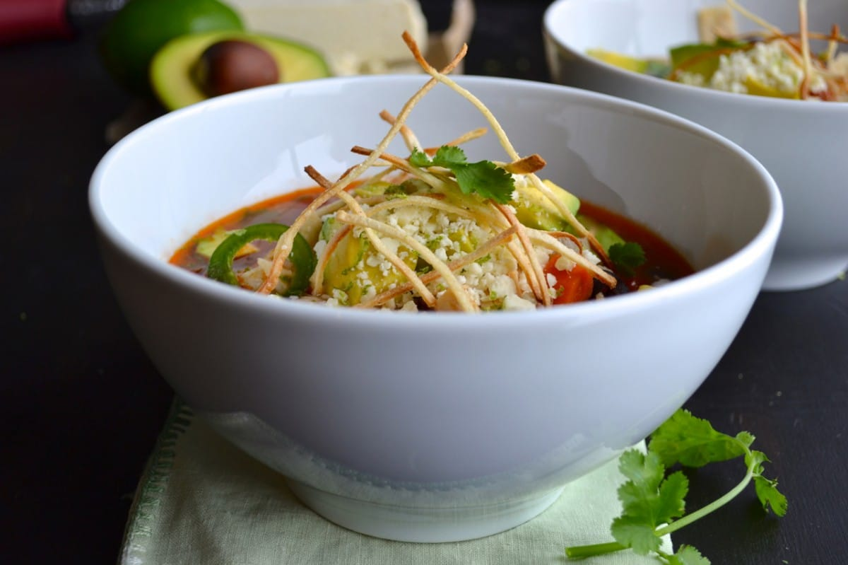 Tortilla Soup topped with avocado, cotija cheese and thin tortilla strips   @tasteLUVnourish