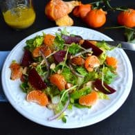 Mandarin Beet Salad with Mandarin Poppyseed Dressing - sweet and juicy mandarins compliment earthy beets with buttery almonds and a crunch from pea shoots. | From @tasteLUVnourish on www.tasteloveandnourish.com