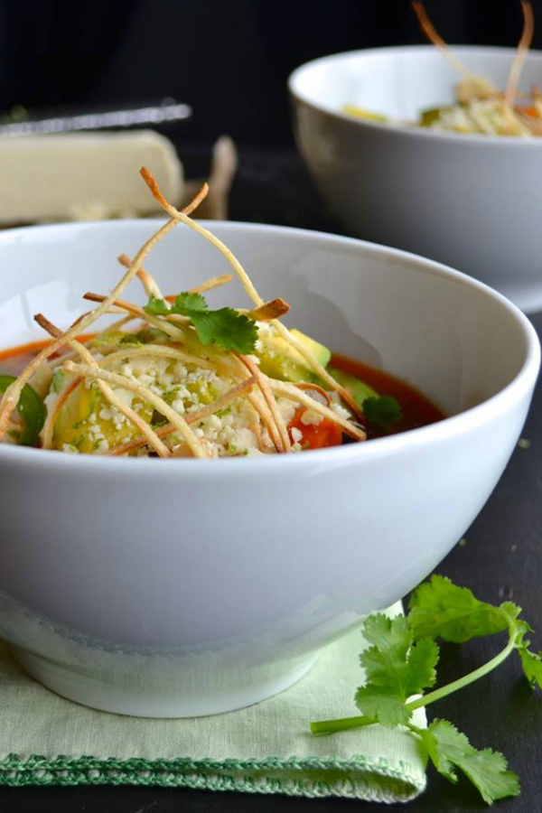 This is the most delicious Tortilla Soup recipe! Spicy, with complex flavors and topped with avocado, cotija cheese and thin crisp tortilla strips. | @tasteLUVnourish