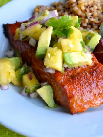 This delicious Chipotle Grilled Salmon with Pineapple Avocado Salsa has a sweet and spicy dry rubbed salmon and topped with an amazing citrusy salsa. | @tasteLUVnourish