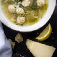 This Italian Wedding Soup made with chicken is light and healthy, but so delicious with buttery Parmesan and a bit of fresh lemon | @tasteLUVnourish