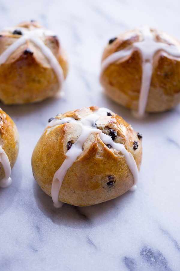 Hot Cross Buns - slightly sweet with a hint of spice and dotted with currants. The perfect little bun. | @tasteLUVnourish on www.tasteloveandnourish.com