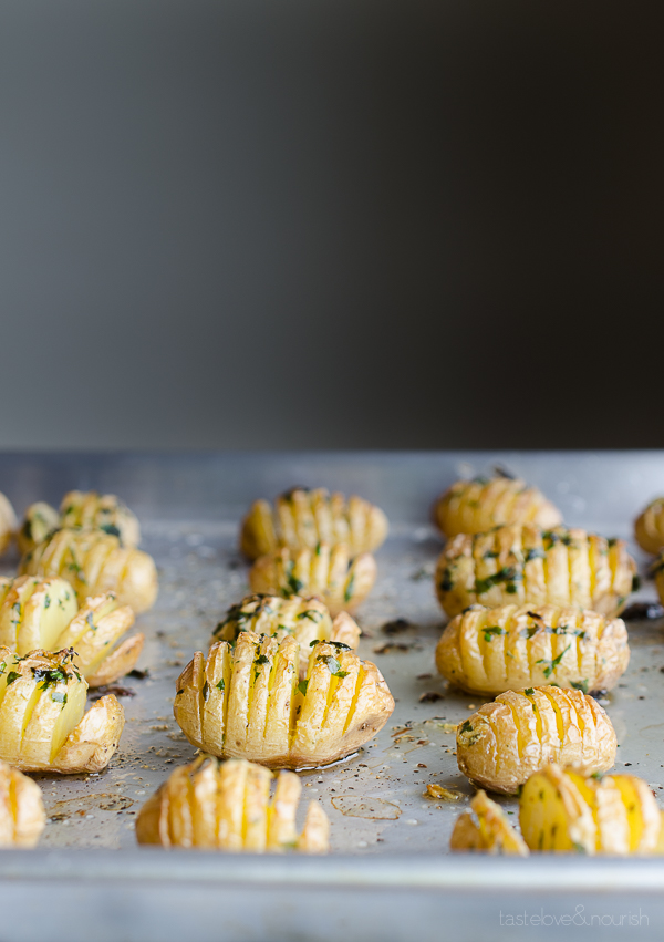 Hasselback Garlic and Herb Baby Potatoes - crispy and delicious!   @tasteLUVnourish on TasteLoveAndNourish.com