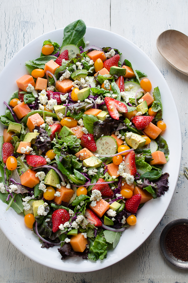 This Strawberry Papaya Salad is loaded with amazing flavors! I love the sweetness from the fruit balanced with the tanginess of the dressing and blue cheese. The added sumac to the lemony vinaigrette enhances the flavors so much. From @tasteLUVnourish on TasteLoveAndNourish.com