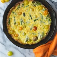 Asparagus Tomato and Cheddar Frittata - this recipe could not be more simple. Perfect for breakfast, brunch or dinner. Use your favorite ingredients with this simple method. | @tasteLUVnourish on TasteLoveAndNourish.com