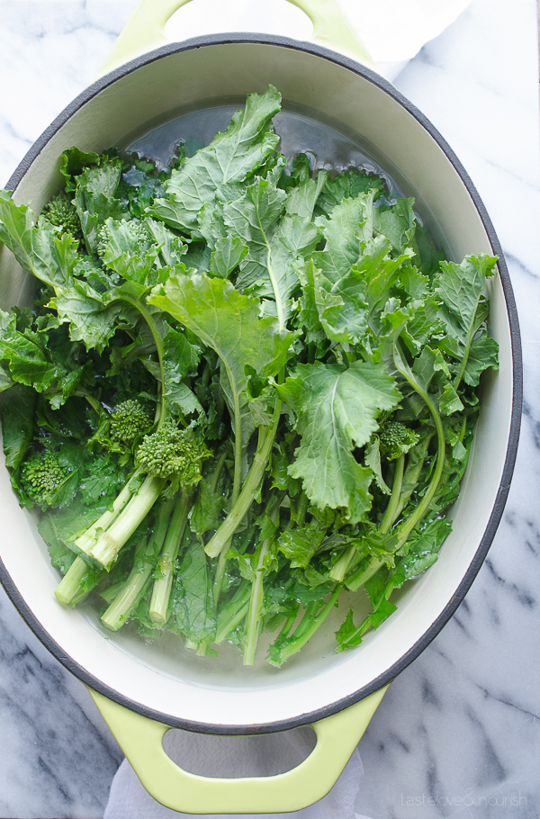 Broccoli Rabe (Rapini) with Garlic Parmesan and Lemon - use these easy steps to prepare broccoli rabe (rapini) for a great side dish. This method removes the bitterness that naturally occurs with broccoli rabe. | @tasteLUVnourish on TasteLoveAndNourish.com