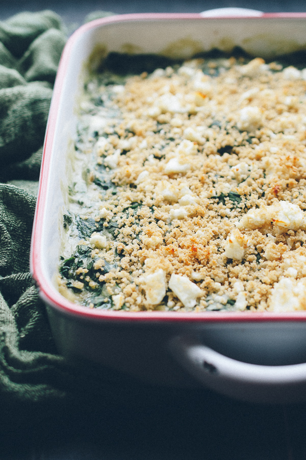 This Baked Creamed Spinach with Feta recipe is AMAZING! So easy, creamy with a bit of crunch from panko and salty bits of feta! It's actually a lightened up recipe, but you'd never know! Vegan options! @tasteLUVnourish