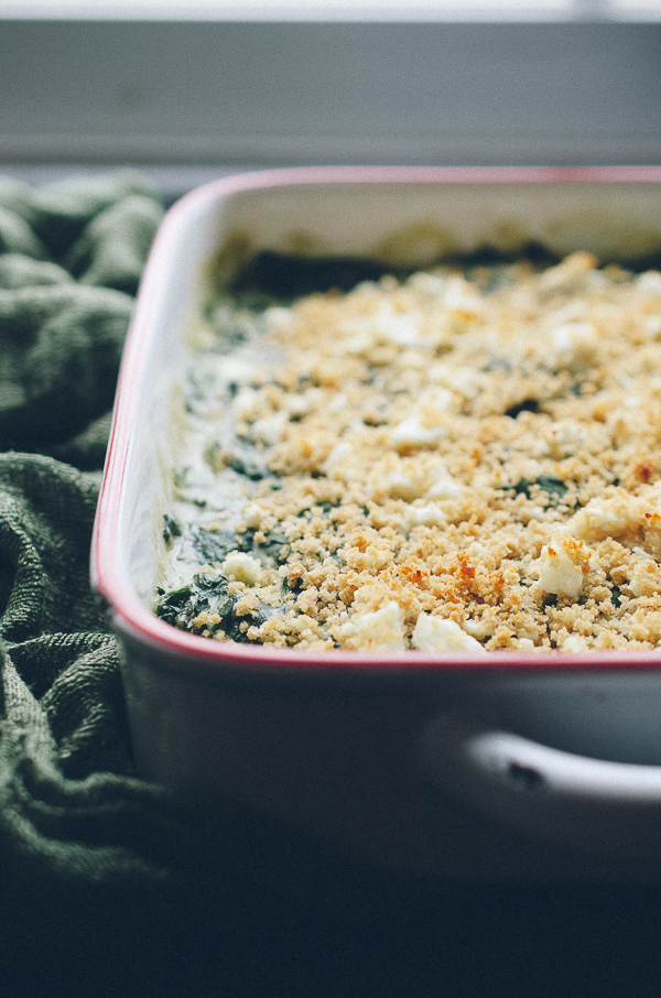 This Baked Creamed Spinach with Feta is AMAZING! So easy, creamy with a bit of crunch from panko and salty bits of feta! It's actually a lightened up recipe, but you'd never know! Vegan options! @tasteLUVnourish