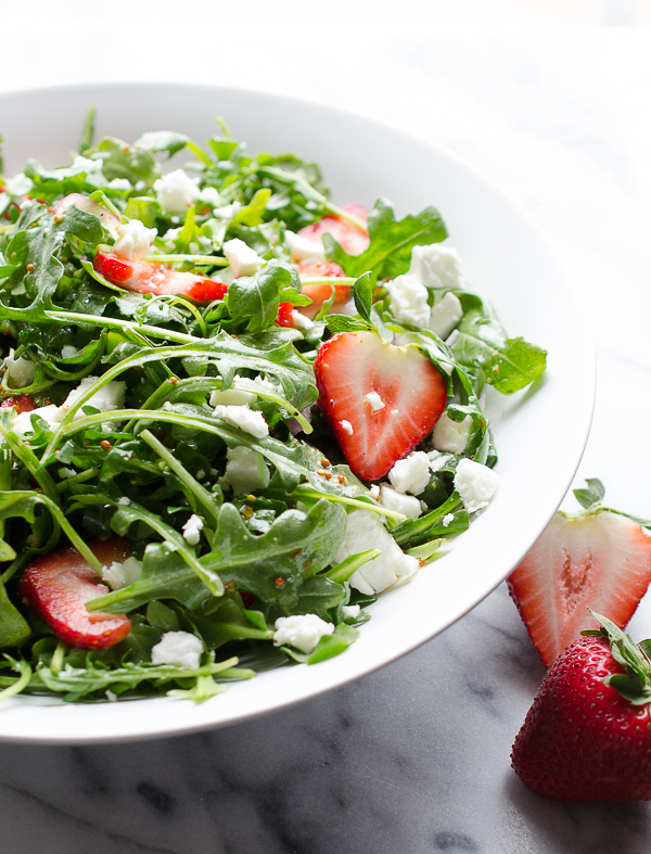 Baby Arugula and Strawberry Salad with Feta-this beautiful salad covers the spectrum of flavors and is a perfect pot luck favorite! From Caroline at Taste Love and Nourish