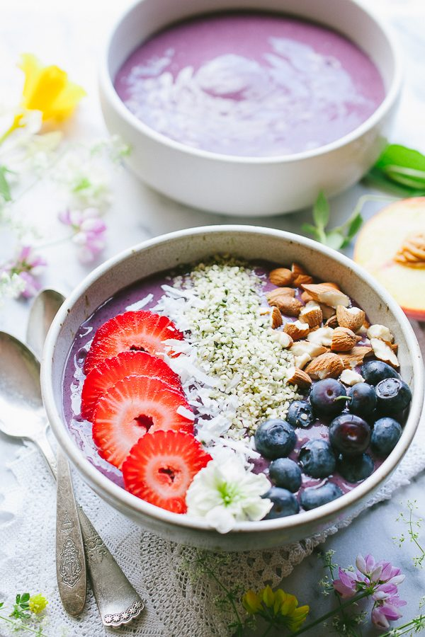 Peach Berry Protein Smoothie Bowl - this easy vegan smoothie bowl is packed with plant based protein! Makes a perfect start to your day or a nourishing snack or dessert! TasteLoveAndNourish.com