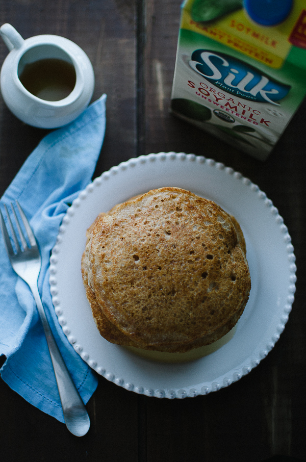 This simple Whole Wheat Vegan Pancake recipe is my family's new go-to! No one will ever guess they are vegan or made with whole wheat! Fluffy, light and delicious! @tasteLUVnourish