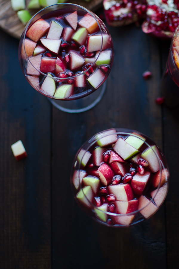 This festive Apple Pomegranate Sangria is a super simple recipe that may become you new favorite cocktail! | @tasteLUVnourish