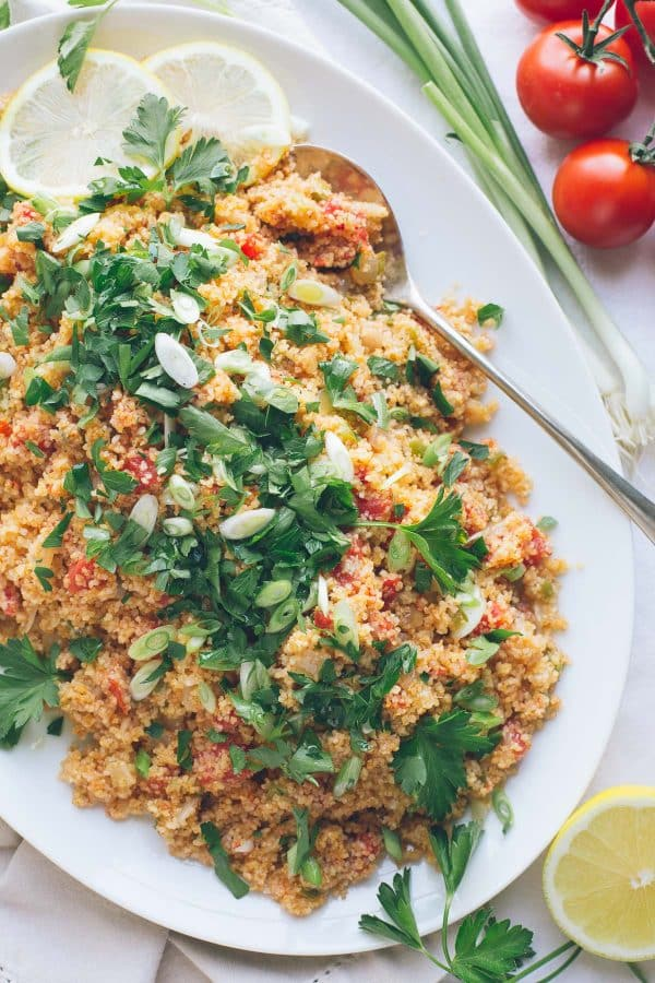 This Armenian Bulgur Salad, called Itch or Eech, is so similar to tabbouleh, but with much less parsley and much less chopping. It's such an easy, delicious fresh grain salad, filling enough for lunch or perfect as a side dish with dinner. | @tasteLUVnourish | Vegan | #immigrantfoodstories
