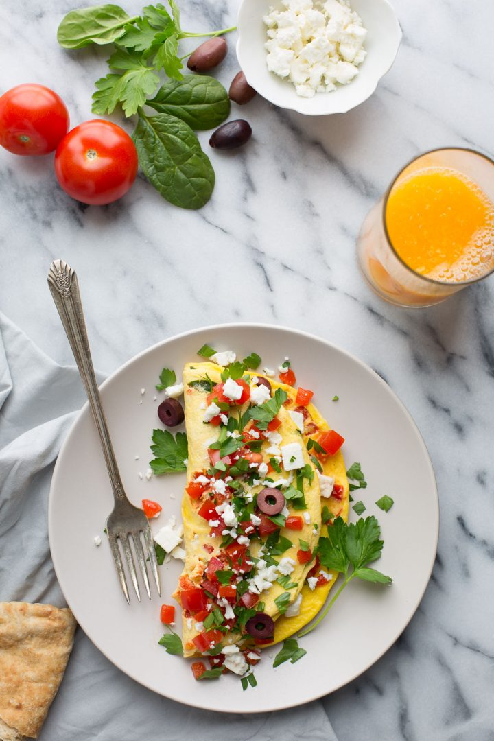 If you love bold Mediterranean flavors, the feta cheese, Kalamata olives, tomatoes and roasted red peppers in this simple and fluffy omelet are calling your name. | @tasteLUVnourish | Vegetarian | Gluten Free