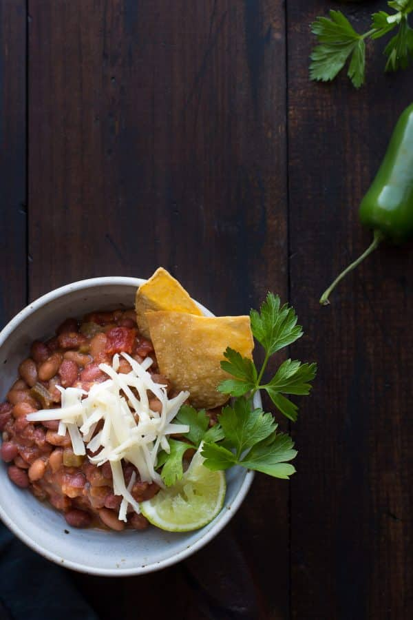 This vegetarian chili has deep smokey flavors complemented by hints of coffee and chocolate. With a bit of spice and a hint of sweetness, this may become your favorite chili! | @tasteLUVnourish | Vegetarian | Vegan | Gluten-Free
