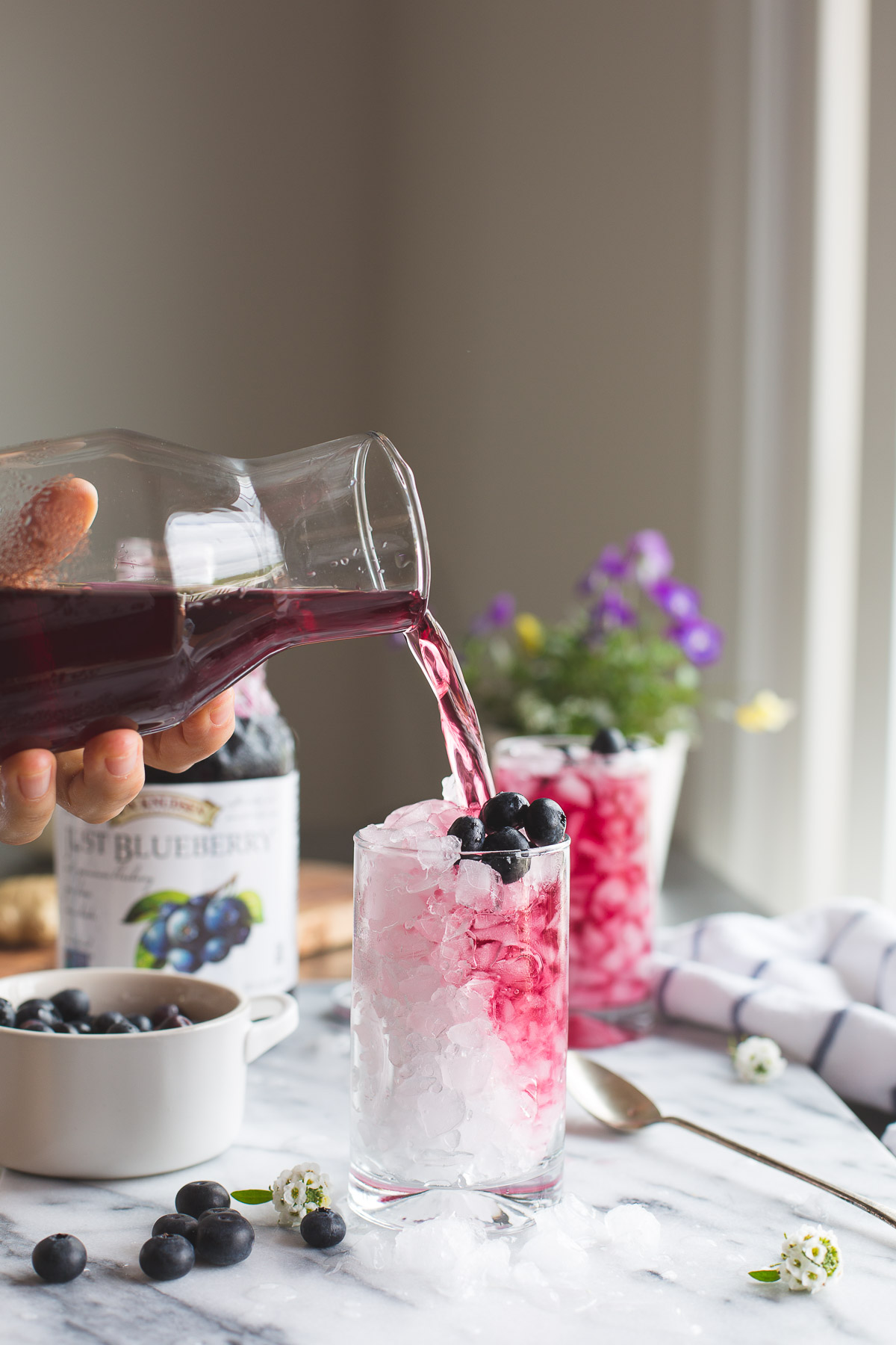 This Blueberry Switchel, or Haymaker's Punch is a fresh twist on an old time farmer's recipe. Do away with artificial sports or energy drinks and enjoy this natural thirst quenching drink. Vegan | Gluten Free | No Refined Sugar | @tasteLUVnourish