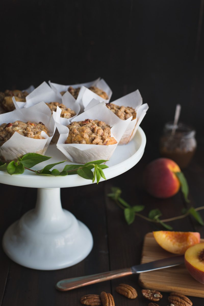 These Peach and Pecan Yogurt Muffins will become that muffin you'll make over and over again. Their tender crumb, sweet bits of peaches and buttery pecans create the perfect summer grab-and-go breakfast, afternoon treat or even midnight snack! From @tasteLUVnourish