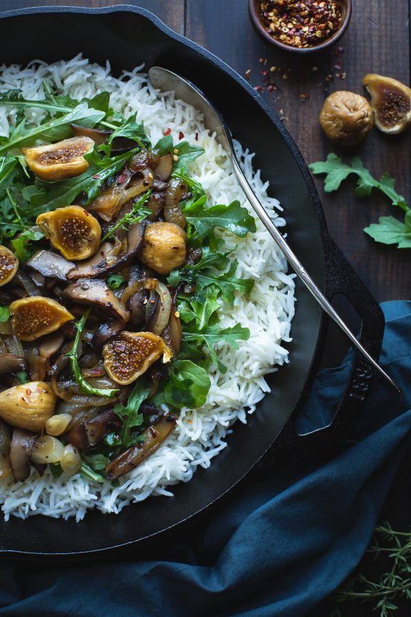 This easy skillet dinner pairs fragrant basmati rice with the bold flavors of deeply caramelized onions and portobello mushrooms with sweet bites of jammy figs and salty crumbles of feta cheese. From @tasteLUVnourish