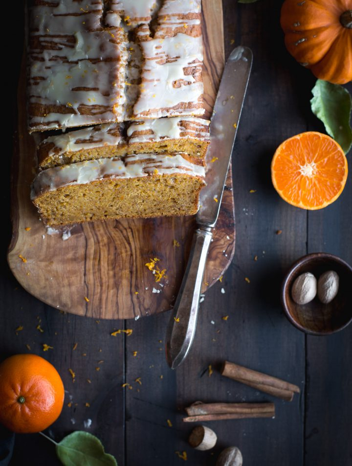 Bump your pumpkin bread up a notch with this Bourbon Glazed Orange Spiced Pumpkin Bread. Fall flavors that will make your mouth super happy, but with a bit less sugar and with heart-healthy fats. Easy, quick and perfect for breakfast, snacks or even dessert! From @tasteLUVnourish #pumpkin #bread #bourbon #glaze #orange #spice #fall #autumn #quickbread #easy #healthy #recipe #tasteloveandnourish #virtualpumpkinparty