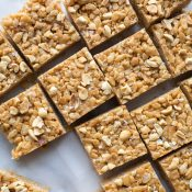 These Salted Peanut Butter Rice Crispy Treats are an easy, sweet and salty treat. Made with no refined sugars and all natural peanut butter, they are vegetarian, gluten free and paleo. From @tasteLUVnourish
