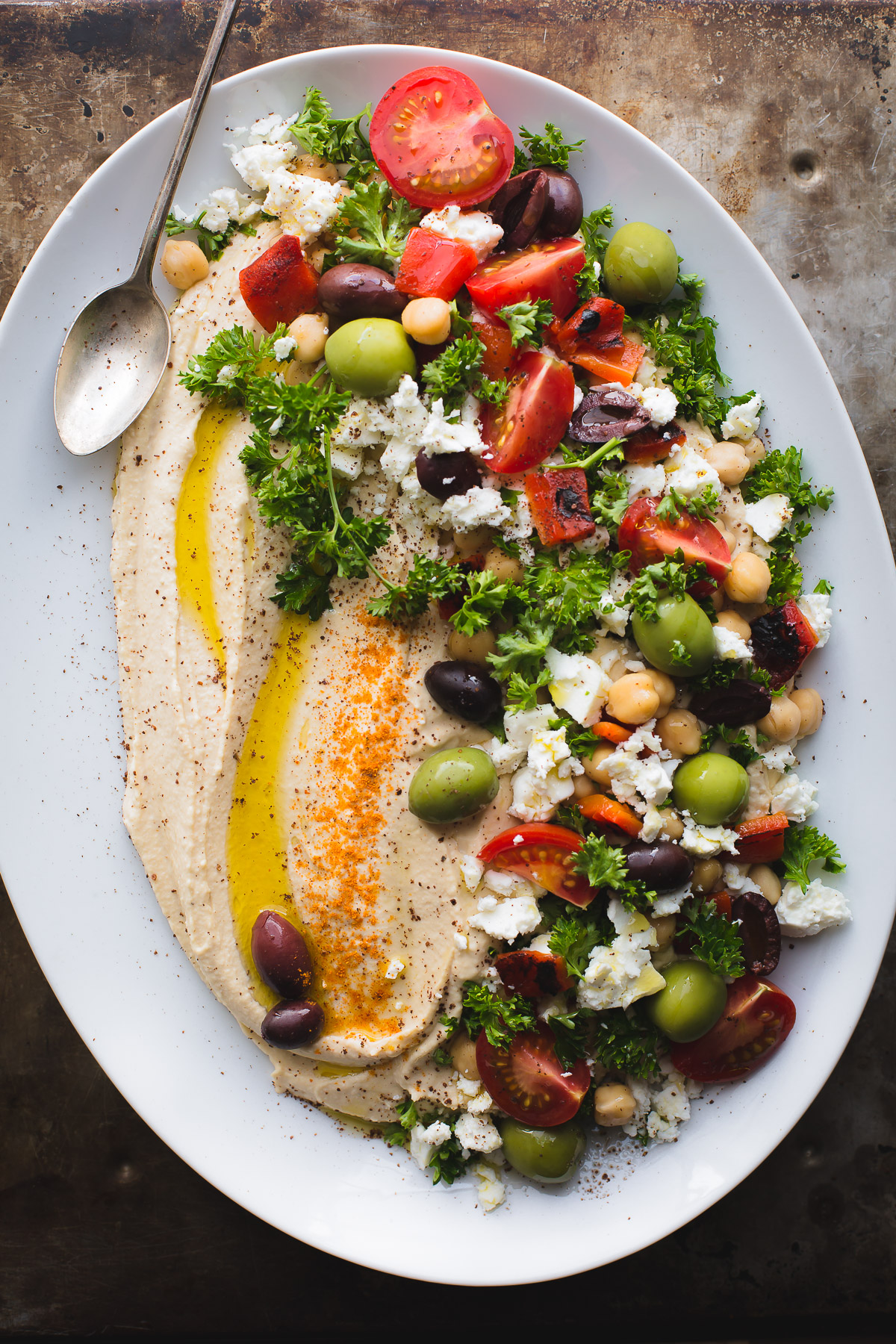 This Loaded Hummus is a great crowd-pleasing appetizer, but the hummus recipe itself is a keeper! Make this regularly and keep a container in the fridge! It's great for snacking, lunches and dinners. Naturally vegan and gluten-free. From @tasteLUVnourish