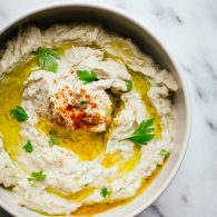 This is the Baba Ganoush I've always wanted to make. Creamy, with just enough texture and lots of smokey eggplant flavor without bitterness. This recipe is naturally vegan and gluten free, making it a great appetizer for a crowd. From @tasteLUVnourish #babaganoush #eggplant #appetizer #vegan #glutenfree #vegetarian