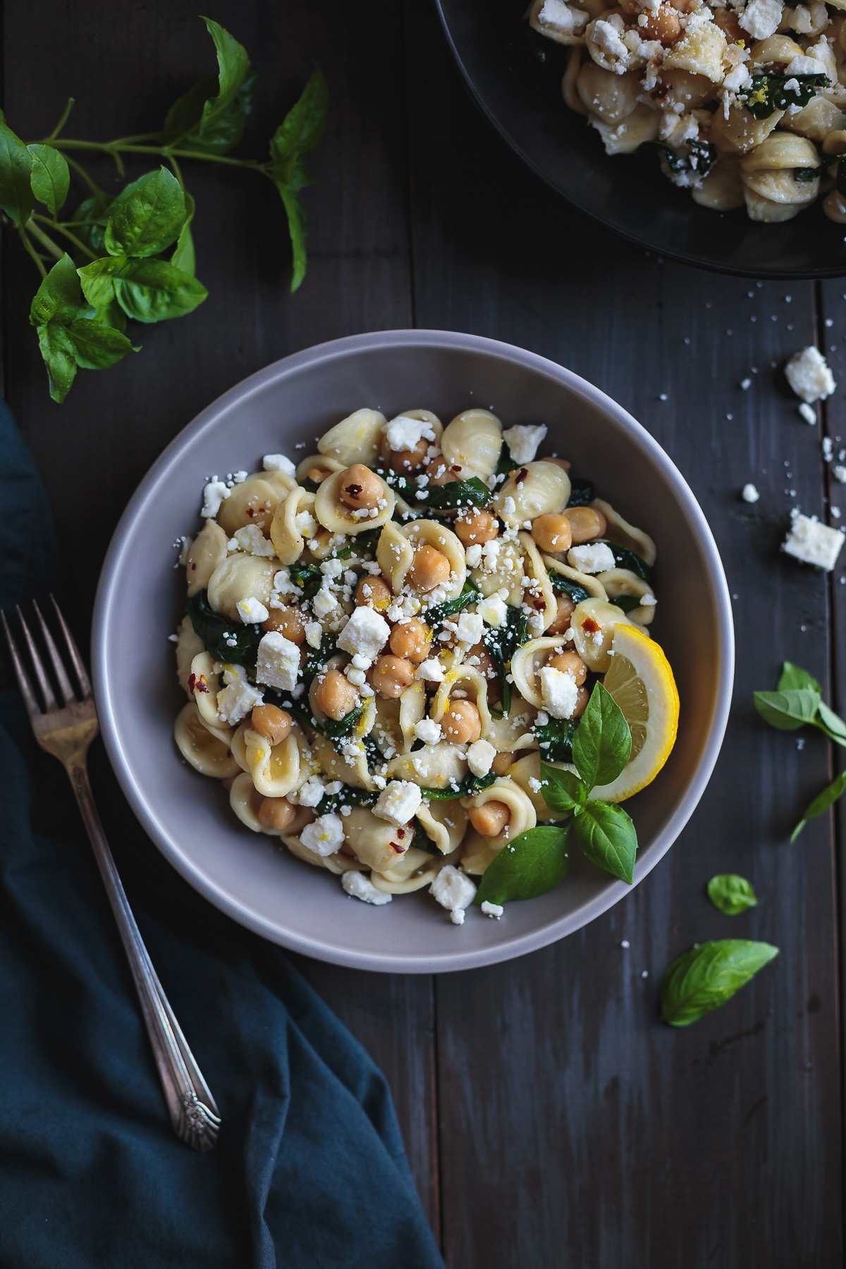 Orecchiette with Chickpeas Spinach and Feta is a simple and quick dinner that tastes incredible! In the time it takes to boil the pasta, you can prepare the rest of the ingredients and have dinner on the table in a flash. From @tasteLUVnourish #orecchiette #chickpeas #spinach #feta #easydinnerrecipes #pastarecipes