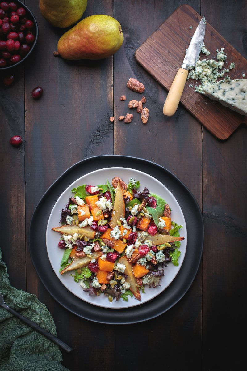 YUM! Roasted Autumn Harvest Salad is so delicious with sweet roasted pears, butternut squash and even roasted fresh cranberries! Top with some buttery pecans and salty blue cheese and you've got salad perfection! From @tasteLUVnourish #autumn #fall #salad #roasted #pears #butternut #cranberry #pecan #bluecheese #glutenfree #vegetarian #veganoptions www.tasteloveandnourish.com