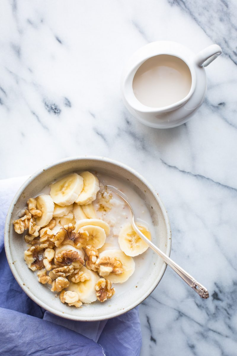 Once you try this Creamy Oat Bran Porridge, you may never go back to traditional oatmeal again. This make-ahead breakfast is the nourishment you need to get your mornings going! #breakfast #porridge #oatbran #oats #recipe #glutenfree #vegan #healthy @tasteLUVnourish
