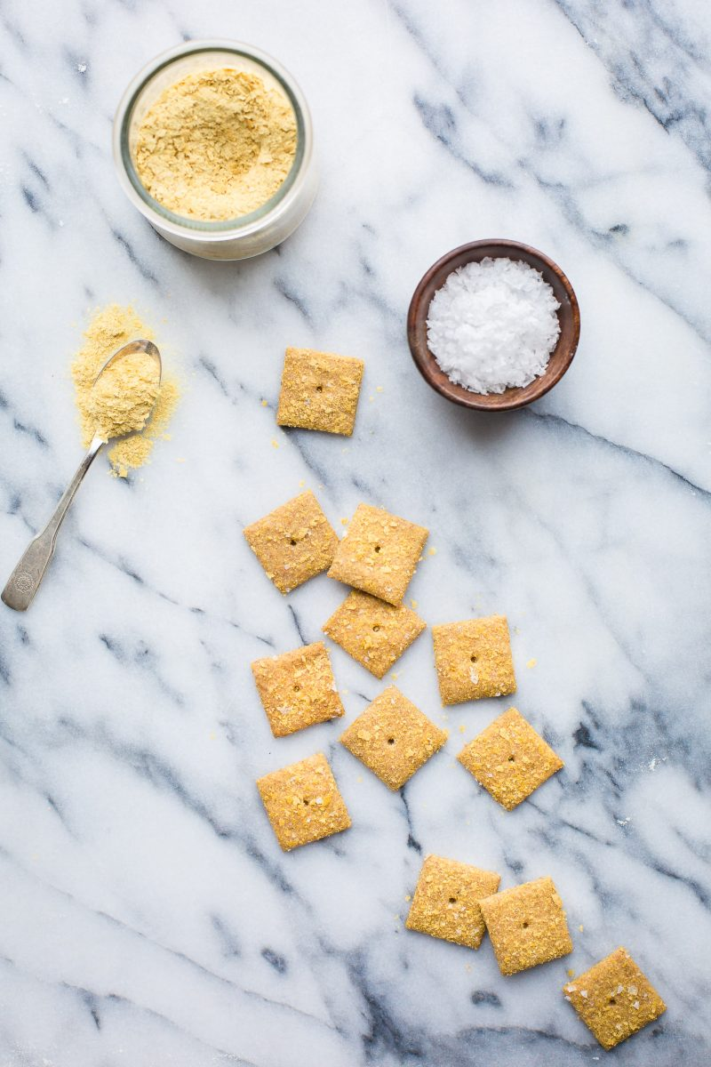 You will love these addicting Sourdough Cheese Crackers made with whole wheat flour and deliciously vegan! Keep a jar in the pantry for a savory, crunchy snack! #sourdough #cheesecrackers #crackers #vegan #recipe #healthy #snack #tasteloveandnourish
