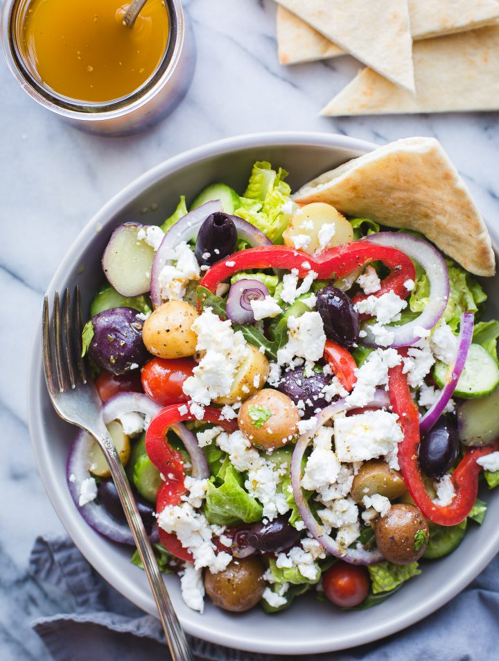 Greek Salad with Baby Potatoes-if you love Zoe's Kitchen's Greek Salad, you need this easy recipe! Makes a great lunch or dinner! #greeksalad #salad #zoeskitchen #saladdressing #easy #recipe #glutenfree #vegetarian #veganoptions #tasteloveandnourish | www.tasteloveandnourish.com