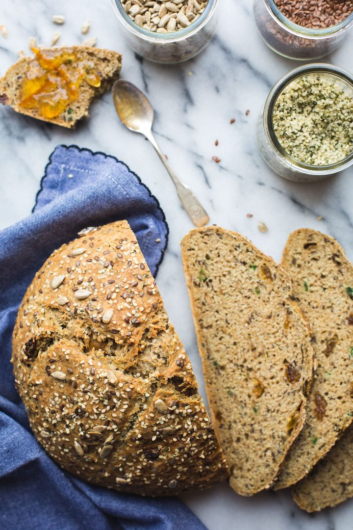 Seeded Soda Bread - This simple Seeded Soda Bread recipe yeilds a homey, delicious loaf speckled with nutty seeds and just a touch of golden raisins. So perfect with a bit of marmalade or just on its own. Plus, this bread has a bit of an unusual surprise… www.tasteloveandnourish.com #sodabread #seeded #wholewheat #irish #stpatricksday #flax #hemp #sunflower #sesame #easy #recipe #bread #vegan #tasteloveandnourish