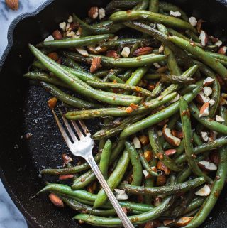 These spicy Seared Sriracha Green Beans with toasty, crunchy almonds and lots of garlic are the simplest and tastiest way to eat green beans!www.tasteloveandnourish.com #greenbeans #sriracha #almonds #takeout #vegan #glutenfree #sidedish #easy #healthy #recipe #dinner #tasteloveandnourish