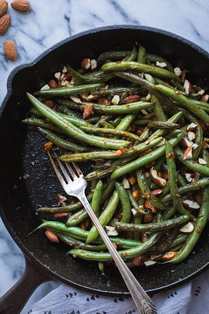 These spicy Seared Sriracha Green Beans with toasty, crunchy almonds and lots of garlic are the simplest and tastiest way to eat green beans! www.tasteloveandnourish.com #greenbeans #sriracha #almonds #takeout #vegan #glutenfree #sidedish #easy #healthy #recipe #dinner #tasteloveandnourish