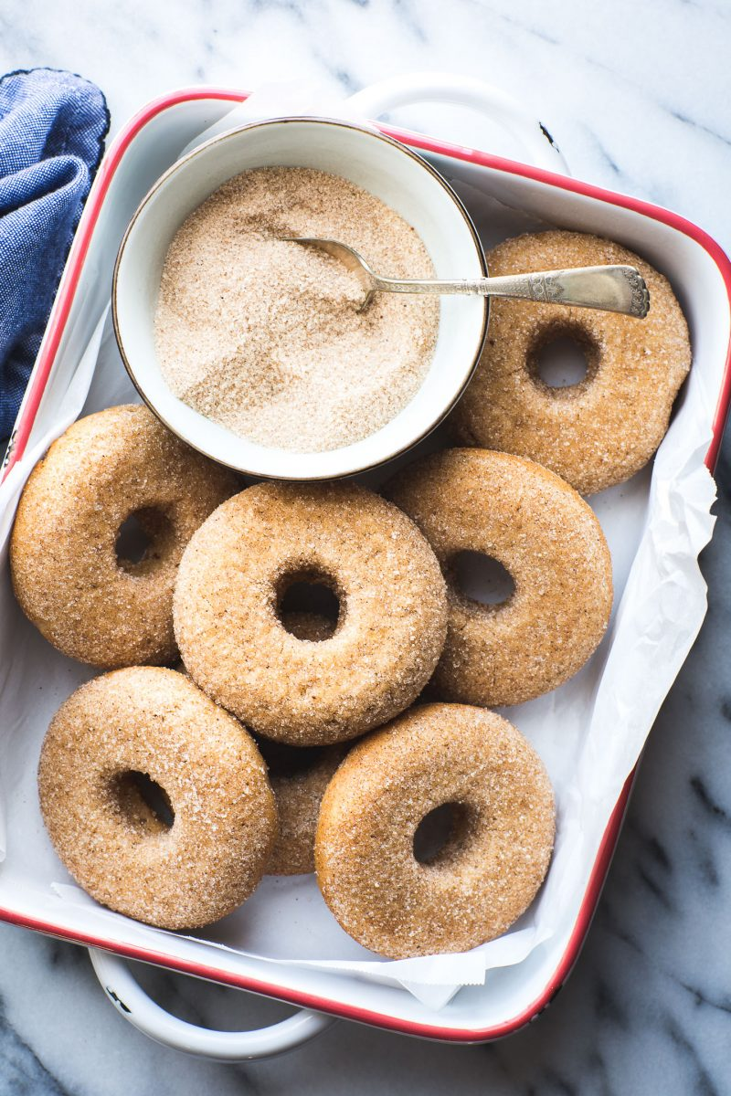 This Vegan Baked Apple Cider Donut recipe yields the tastiest donuts with lots of apple flavor and the perfect blend of spices. They'll definitely satisfy your biggest cider donut cravings! #vegan #baked #apple #cider #donut #doughnut #breakfast #snack #dessert #fall #recipe #tasteloveandnourish