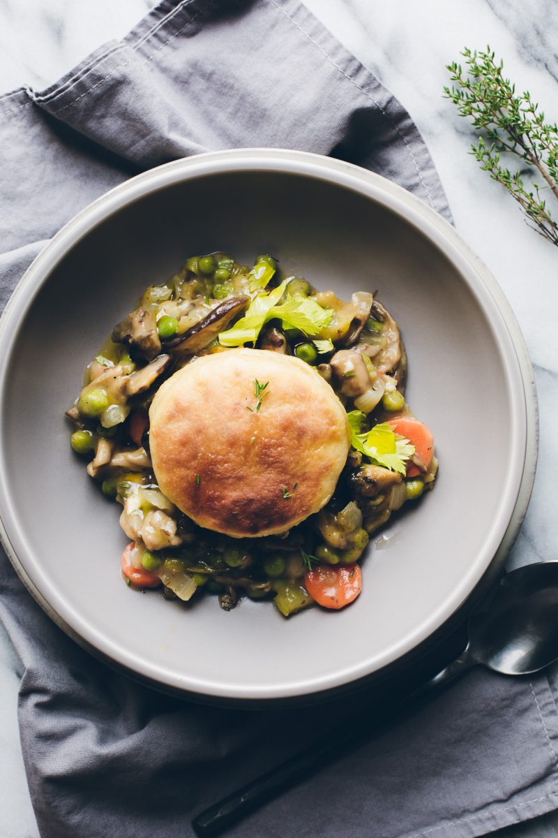 Dinner bliss in one pot! This vegan Vegetable Pot Pie topped with Olive Oil Biscuits makes a homey dinner that everyone will love. This biscuit recipe alone, is everything! #vegan #onepot #dinner #vegetable #potpie #oliveoil #biscuits #easy #healthy #recipe #tasteloveandnourish www.tasteloveandnourish.com