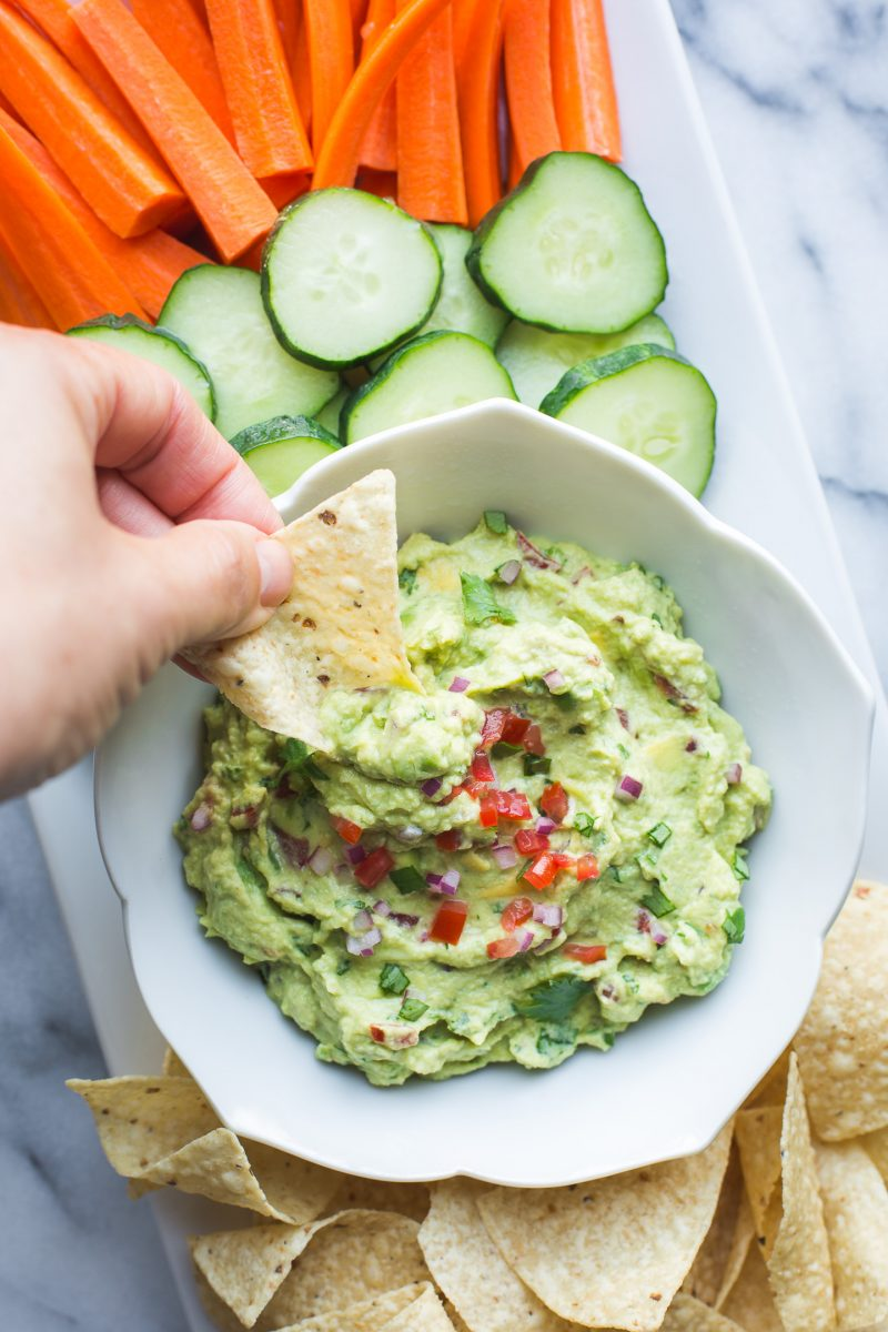 Made with both edamame and avocado, this guacamole is lower in fat and has a boost of protein compared to traditional guac. Serve this with veggies, tortilla chips or use as a spread on wraps and sandwiches. #edamame #avocado #guacamole #healthy #easy #protein #vegan #glutenfree #appetizer #spread #lunch #snack #recipe #tasteloveandnourish From www.tasteloveandnourish.com