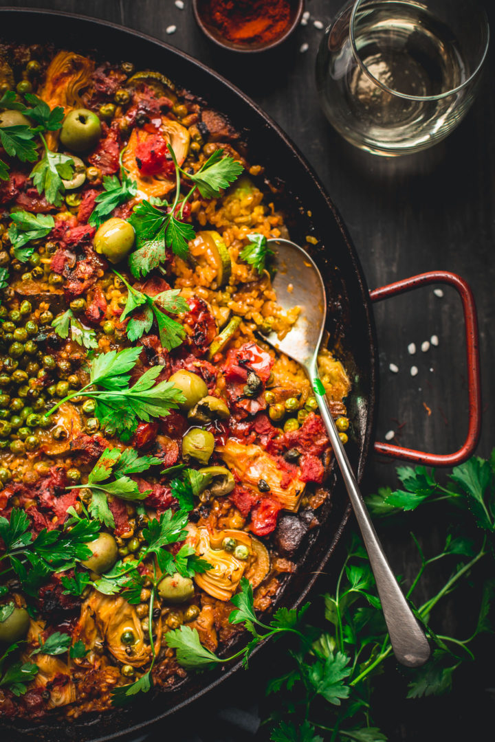 Made in one pan, this Vegetable Paella is a tasty spin on the traditional Spanish dish. It's loaded with smokey flavor and lots of veggies. Perfect for weekends and entertaining! #vegan #glutenfree #vegetarian #vegetable #paella #onepot #dinner #healthy #recipe #entertaining #tasteloveandnourish